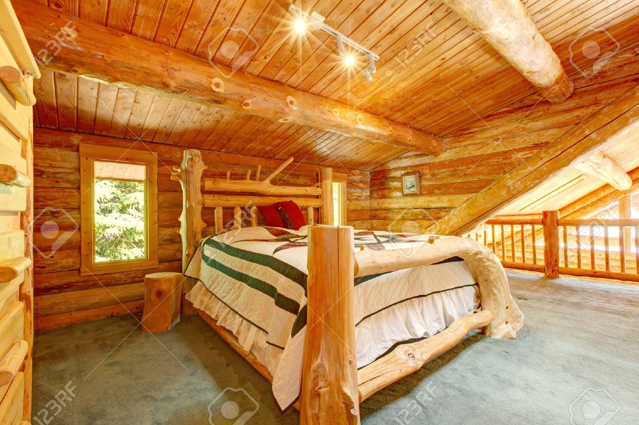 Log Cabin Bedroom Under Wood Large Ceiling With Queen Size Bed. Stock Photo    13354774