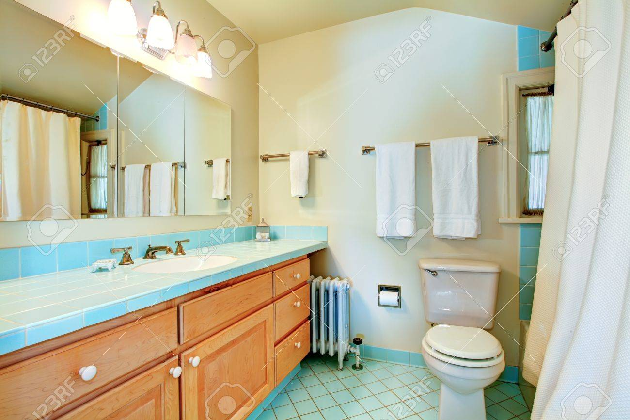 Old antique bathroom with blue tiles and white shower. Stock Photo - 13352876