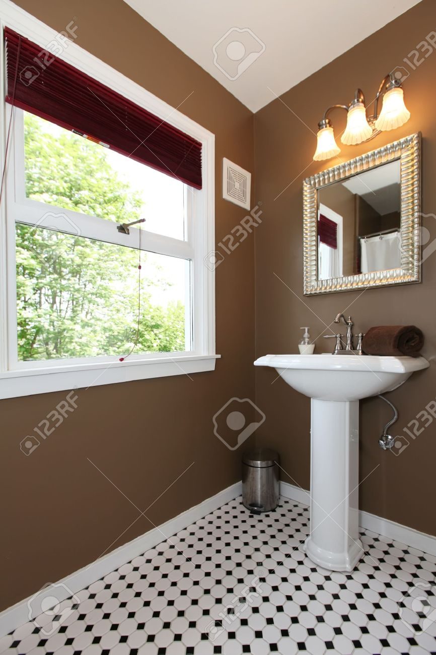 Classy Brown small bathroom with antique sink and tiles Stock Photo - 13888929