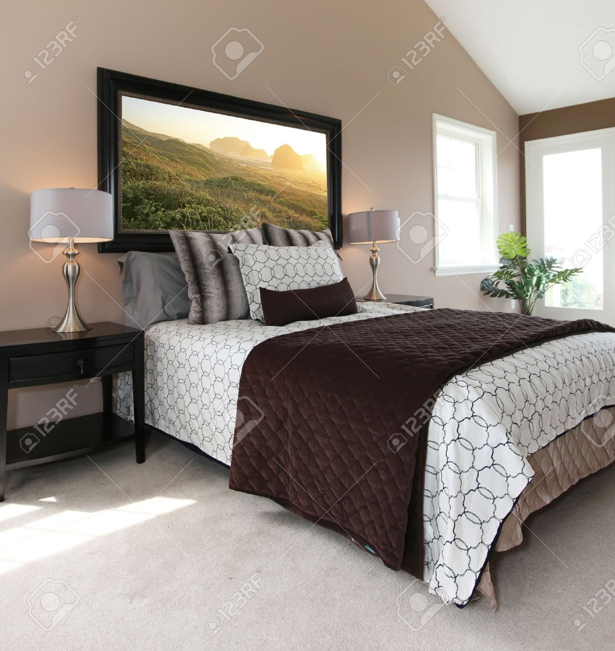 Bedroom With Modern White And Brown Bed And Nightstands Stock Photo Picture And Royalty Free Image Image 13888922