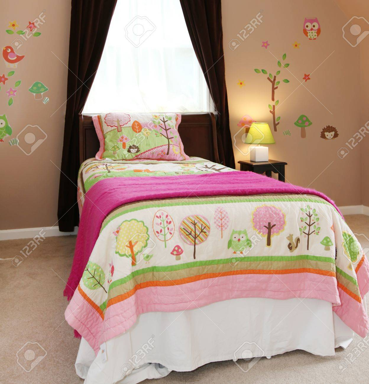 Baby girl kids bedroom interior with pink bed and brown walls. Stock Photo - 13888918