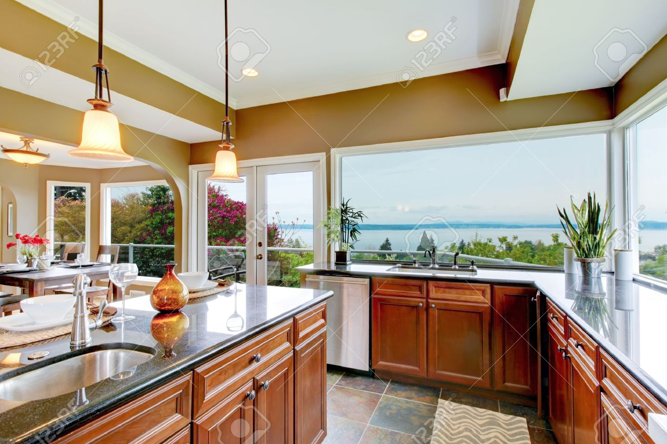 Modern luxury kitchen with water view, island and sink. Stock Photo - 13888936