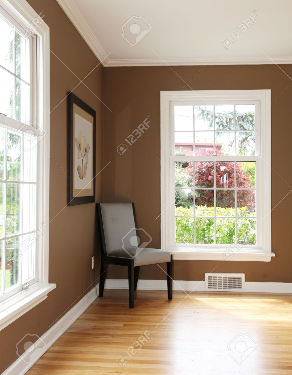 Living Room Corner With Chair And Two Windows Hardwood Floor Stock Photo