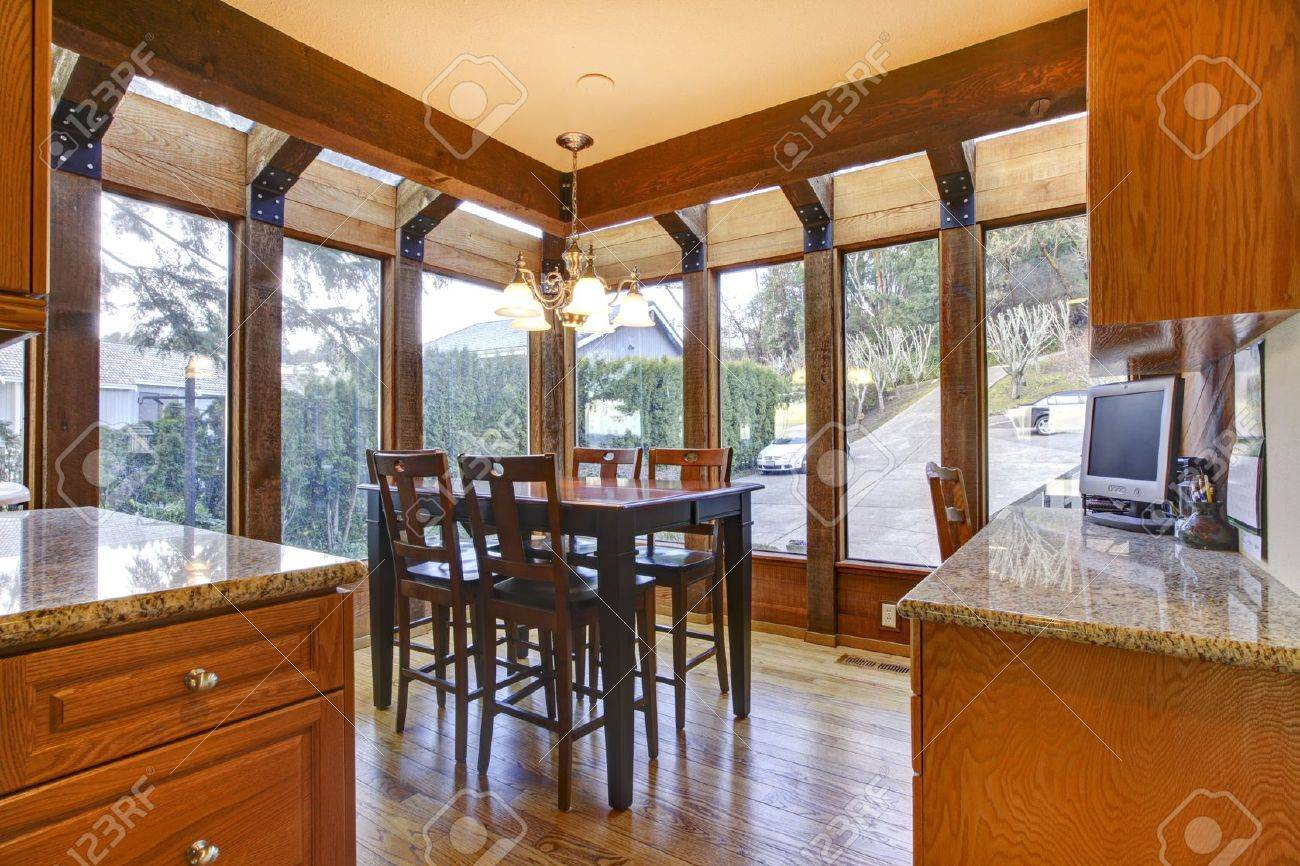 breakfast room wth wood floor and cherry cabinets stock photo