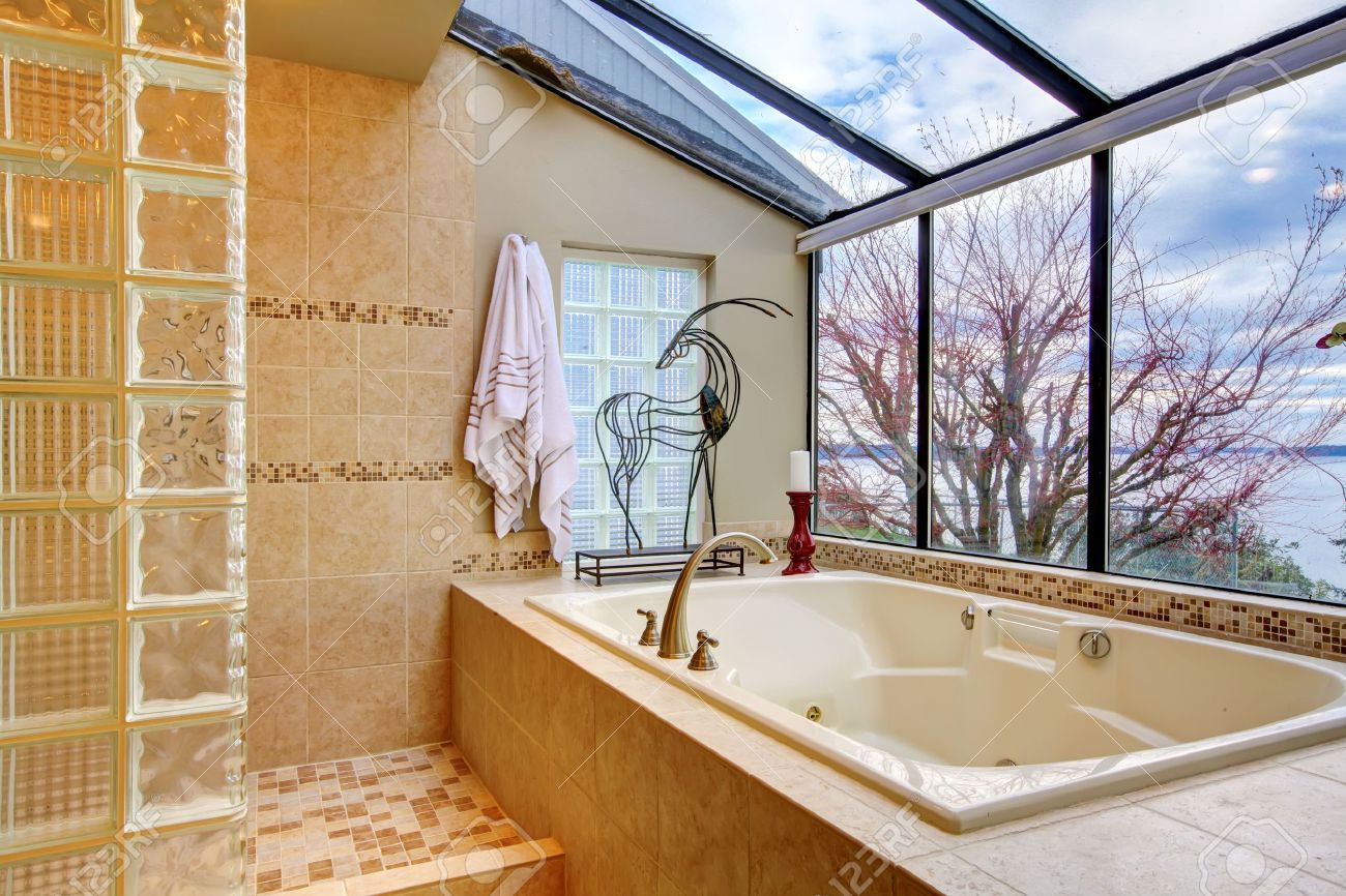 Large Tub With Glass Wall And Water View Near Shower. Stock Photo ...