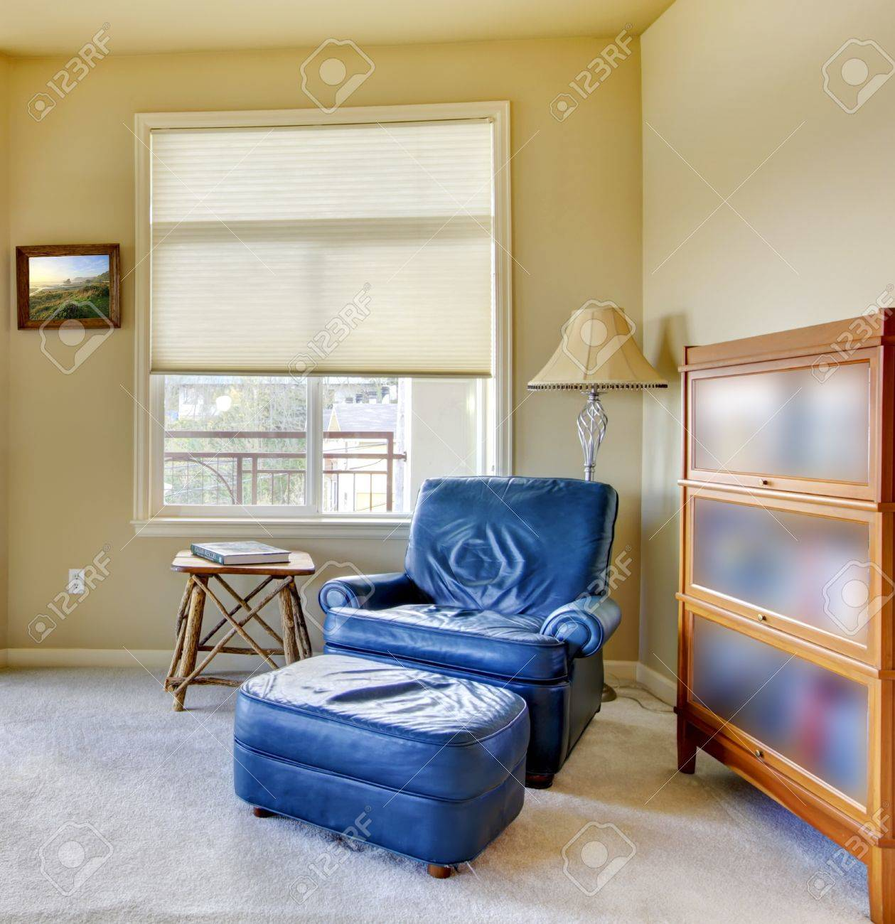 Living room with blue chair and book shelve. Stock Photo - 14287604