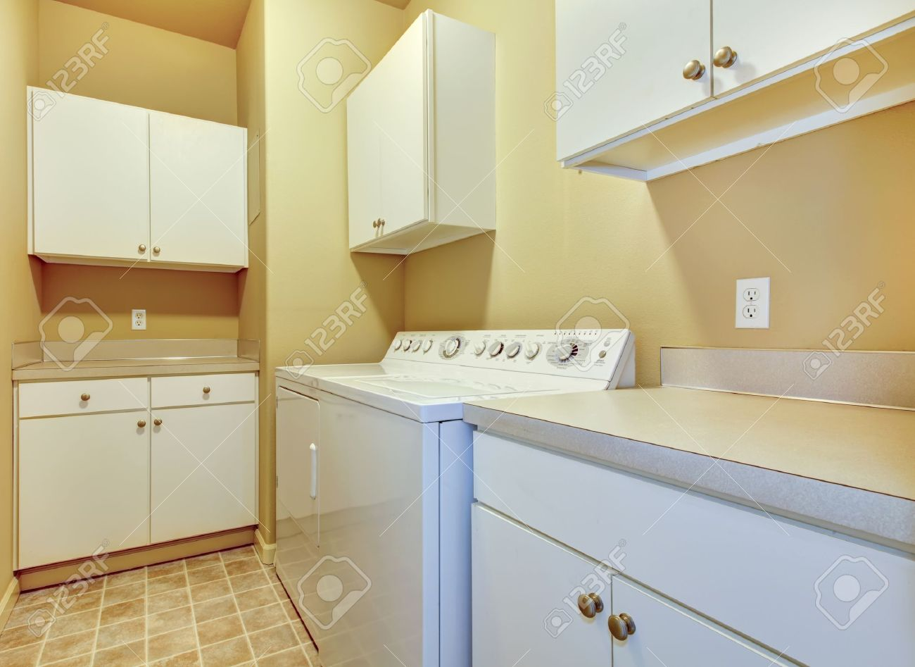 Fabulous Simple Laundry Room With Beige Walls And White Cabinets Interior Design Ideas Gentotryabchikinfo