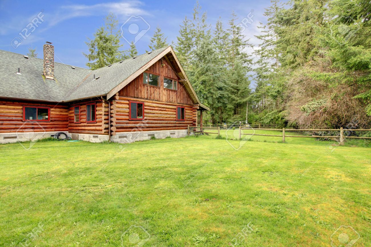 Spring landscape and rustic old log cabin. Stock Photo - 14295754