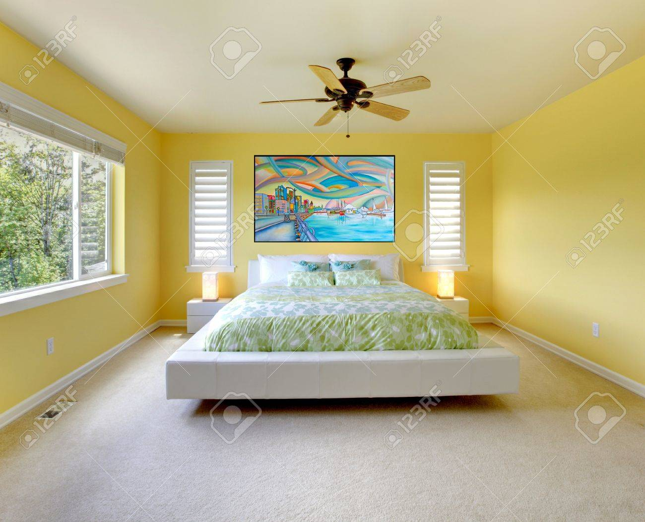 Yellow modern bedroom interior with white bed. Stock Photo - 14287622