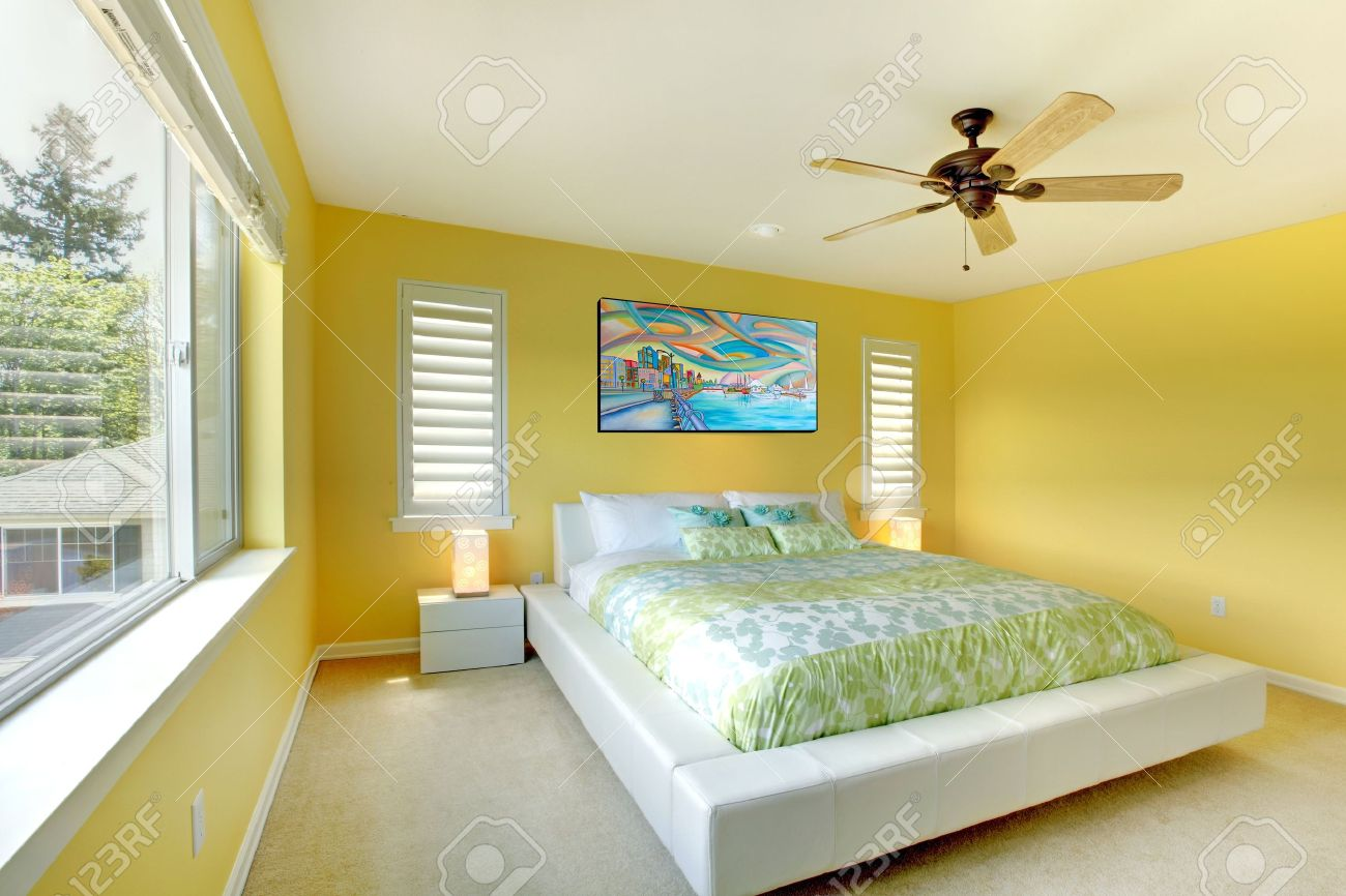Exceptionnel Stock Photo   Yellow Bright Bedroom With Green Bedding And White Bed.