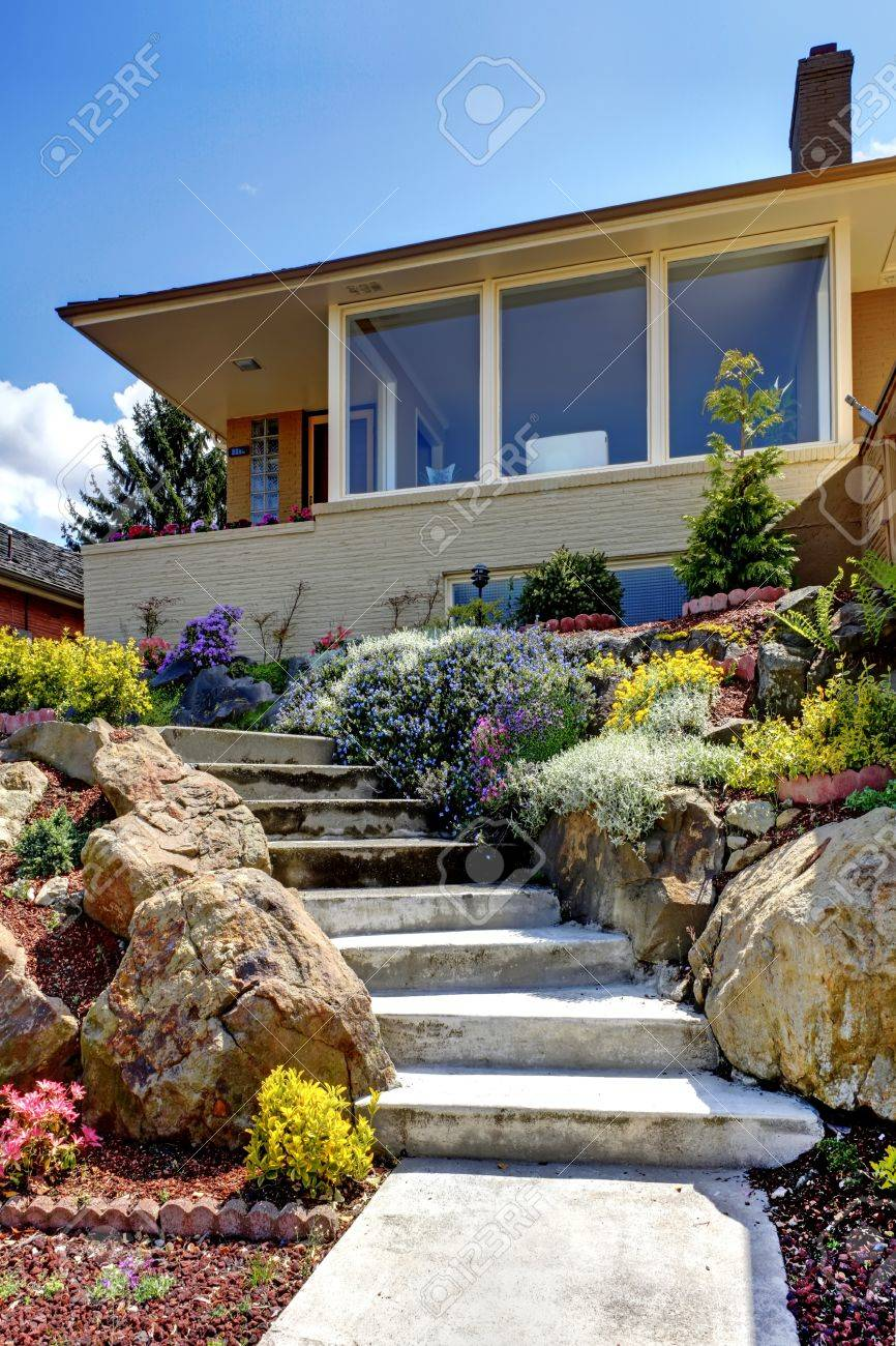 One Story Modern House Exterior With Staircase And Flowers Stock