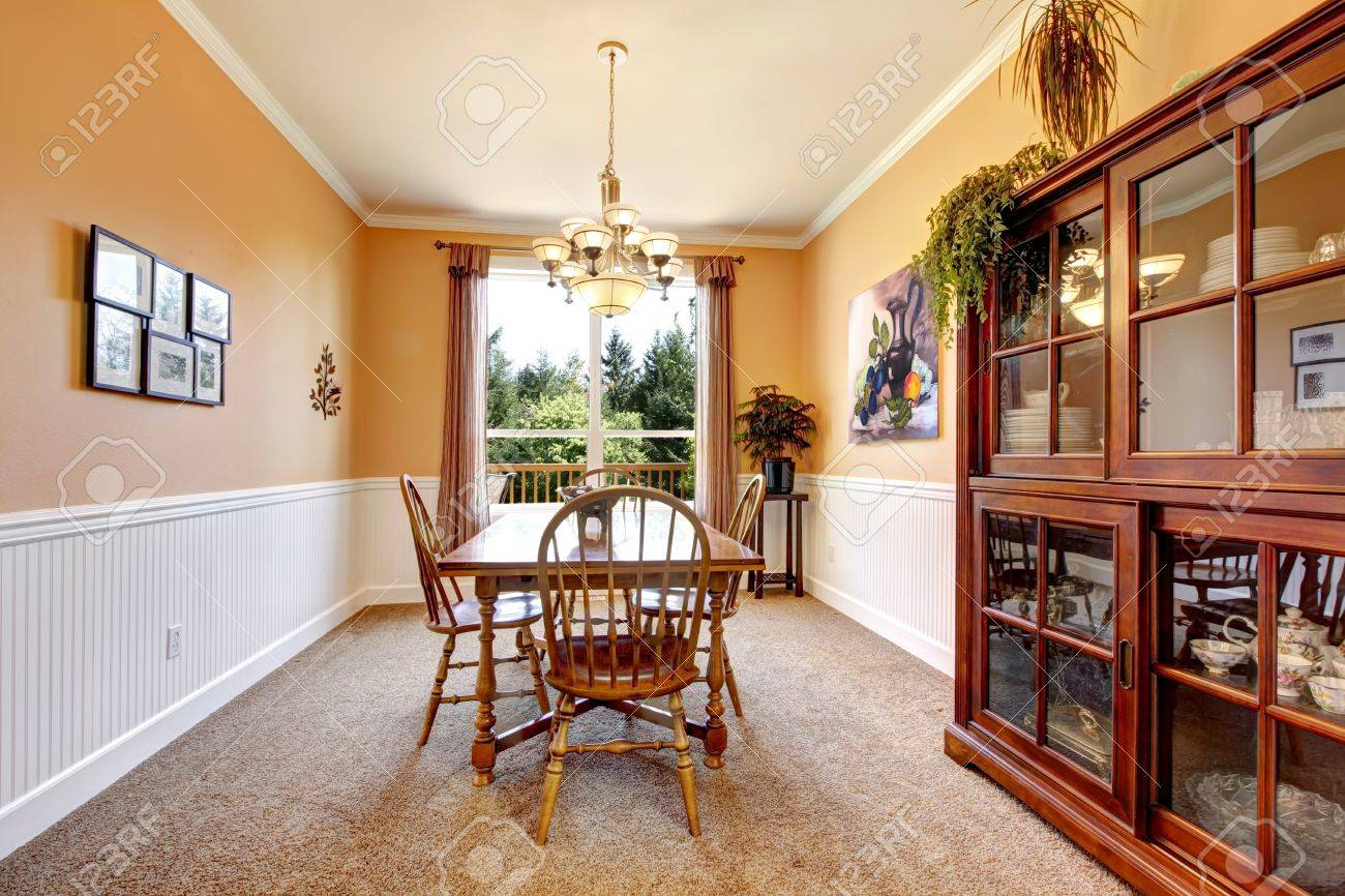 peach color dining room with beige carpet and simpel furniture