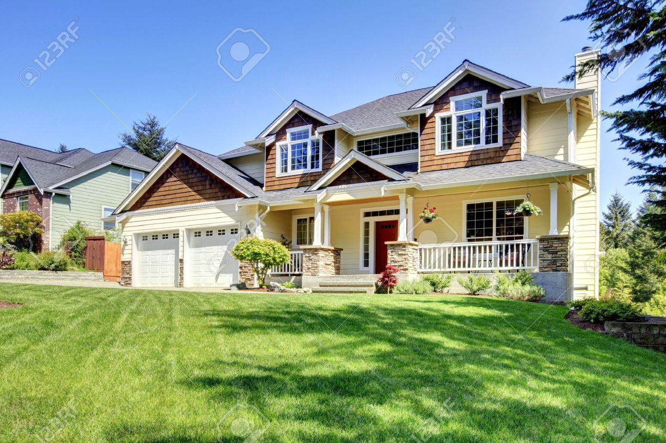 Large American beautiful house with red door and two white garage doors. Stock Photo - 14615291