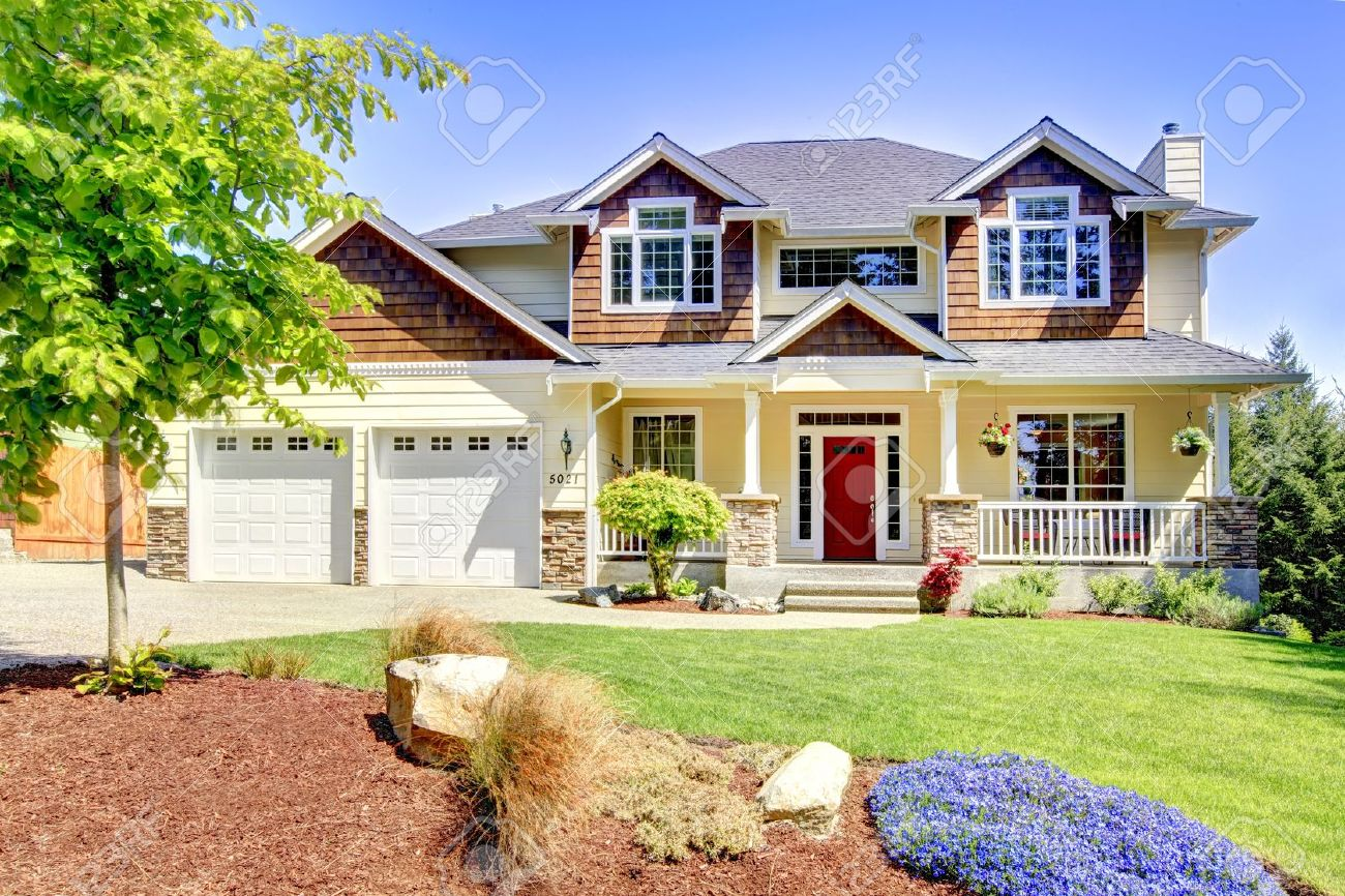 Large American beautiful house with red door and two white garage doors. Stock Photo - 14615284