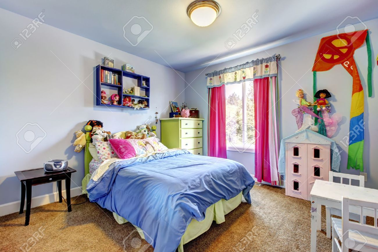 Large Bedroom Blue Bedroom Of The Baby Girl With Toys And Large Bed Stock Photo