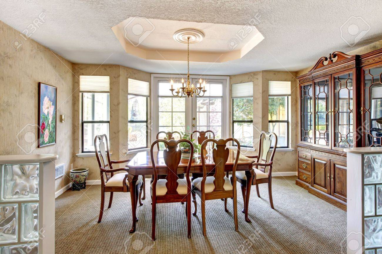 Elegant Dining Room Interior With Brown Table And Chairs. Stock ...
