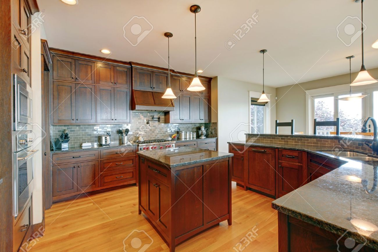 Luxury pine wood beautiful custom kitchen interior design with island and granite. Stock Photo - 14874104