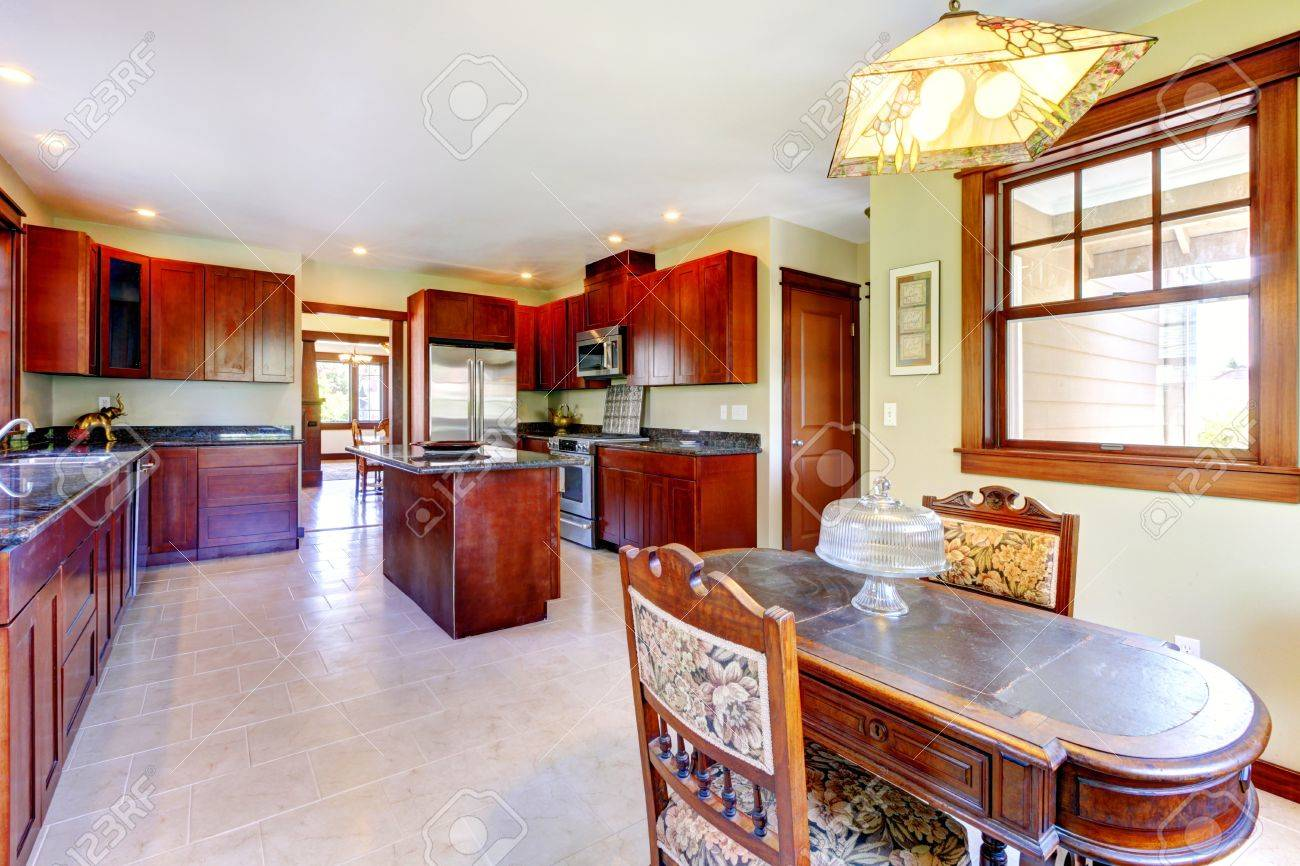 Large Chery Wood Kitchen With Dining Room Table And Tile Floor ...