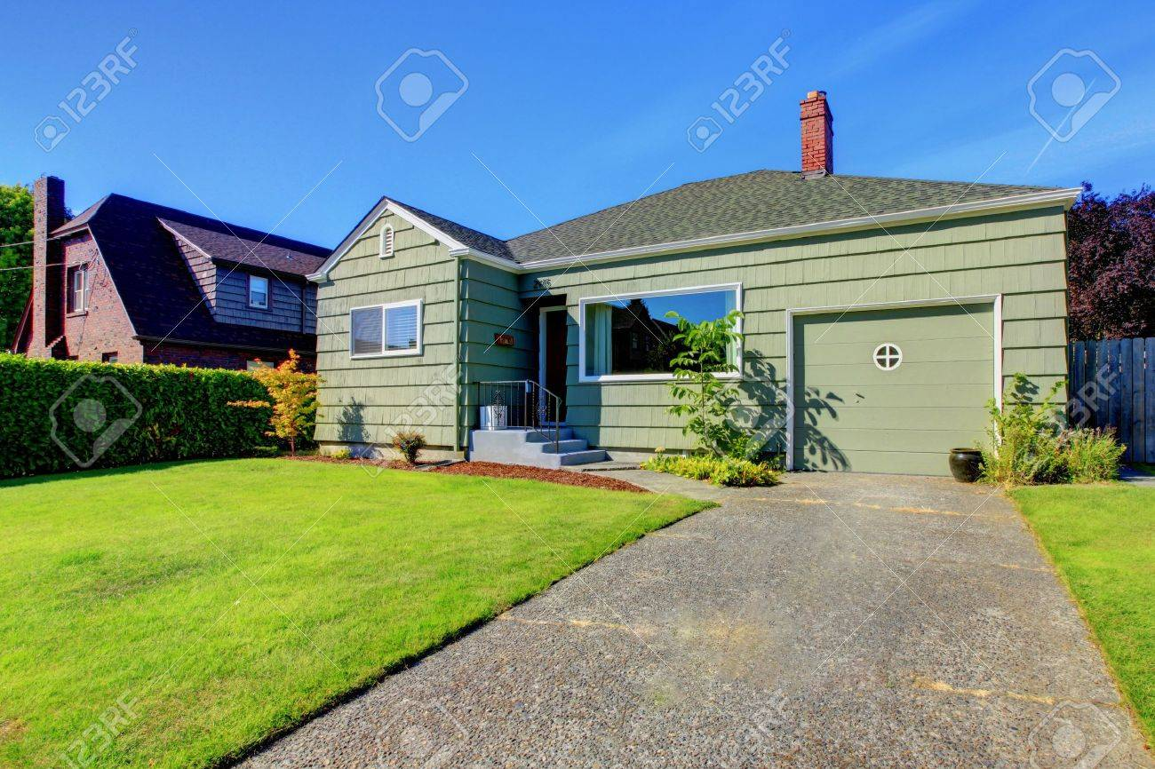 Small one story house with garage and driveway stock photo 14968405