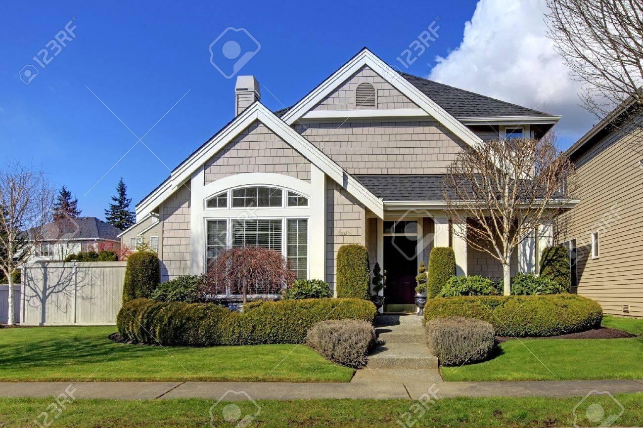 Classic New Beige American House Exterior In The Spring. Stock Photo ...