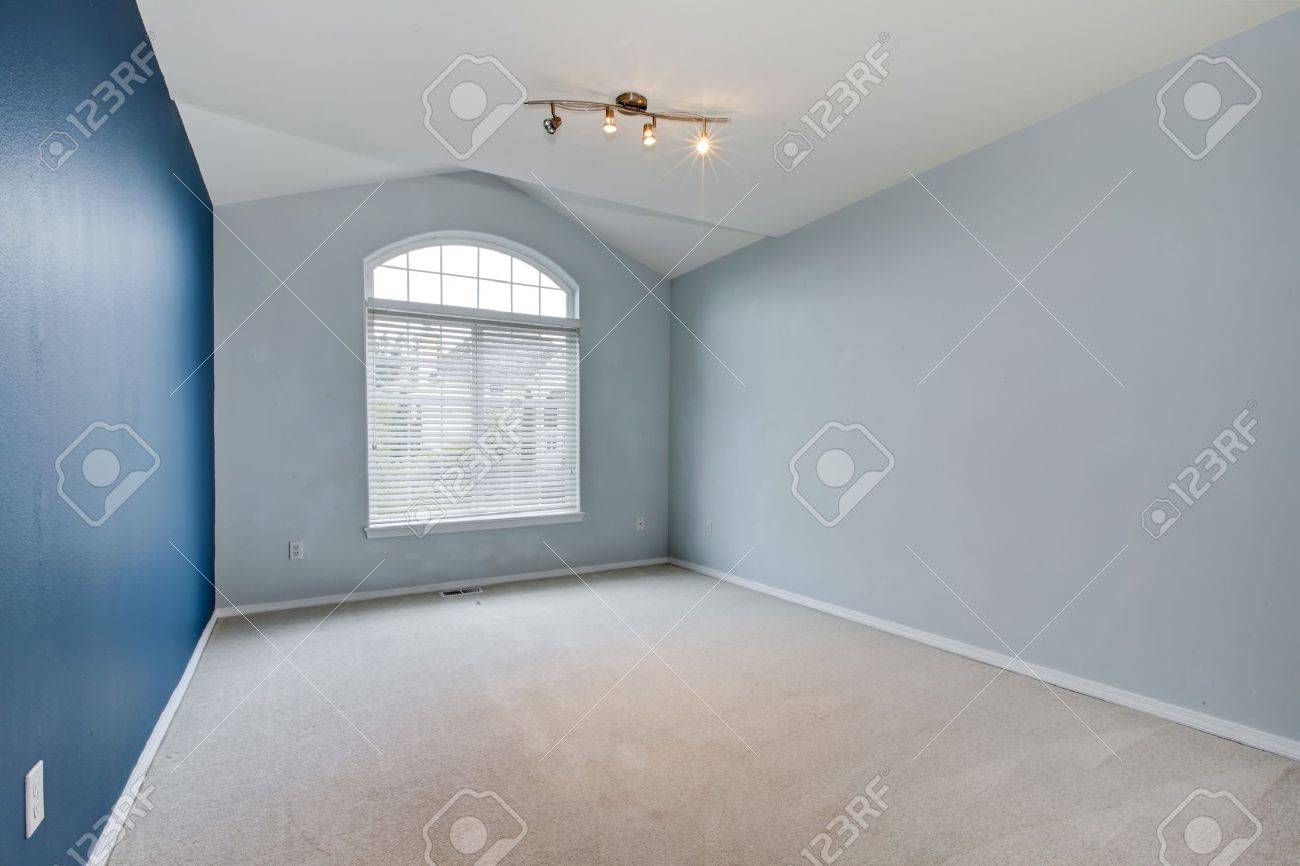 Blue large empty room with carpet and vaulted ceiling with huge window. Stock Photo - 15959923