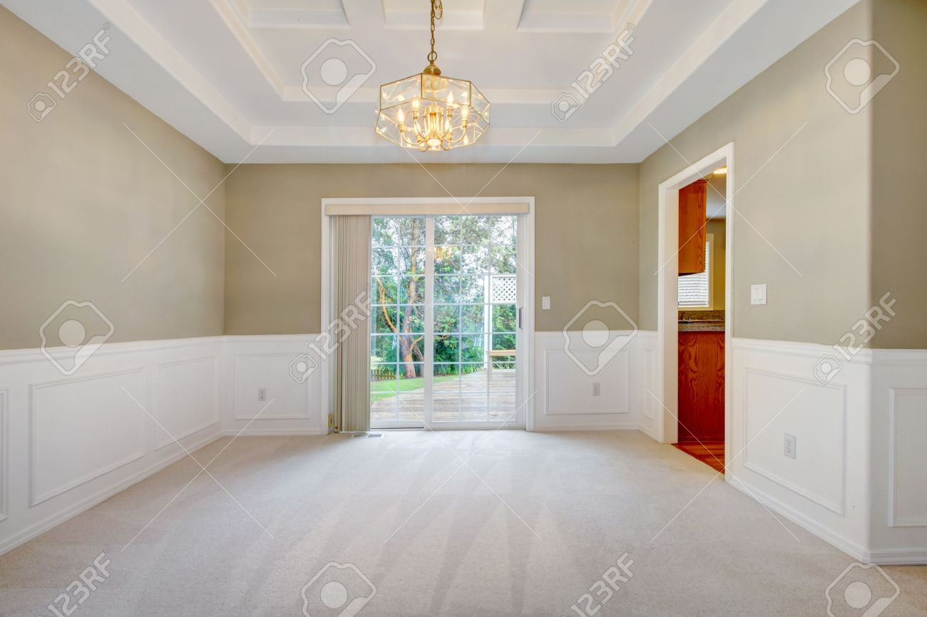 Empty living room with carpet - Empty Luxury Home Interior With Beige Carpet Of Dining And Living Room Stock Photo