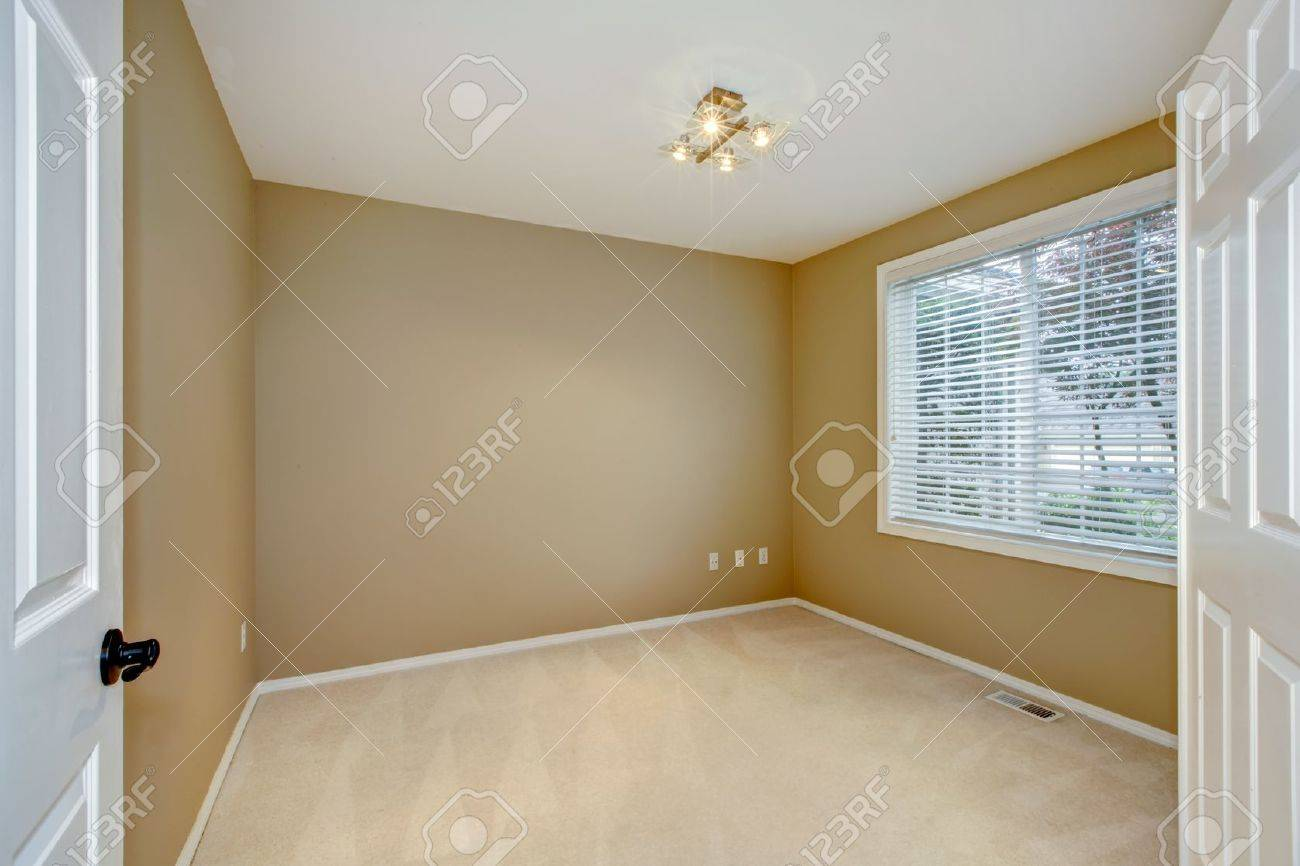 empty new bedroom interior with brown and beige and open large white doors stock photo