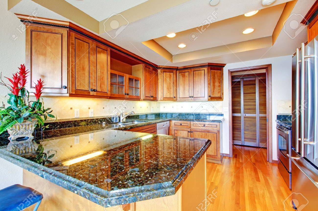 Luxury apartment wood kitchen with granite countertop and cherry hardwood Stock Photo - 16306559