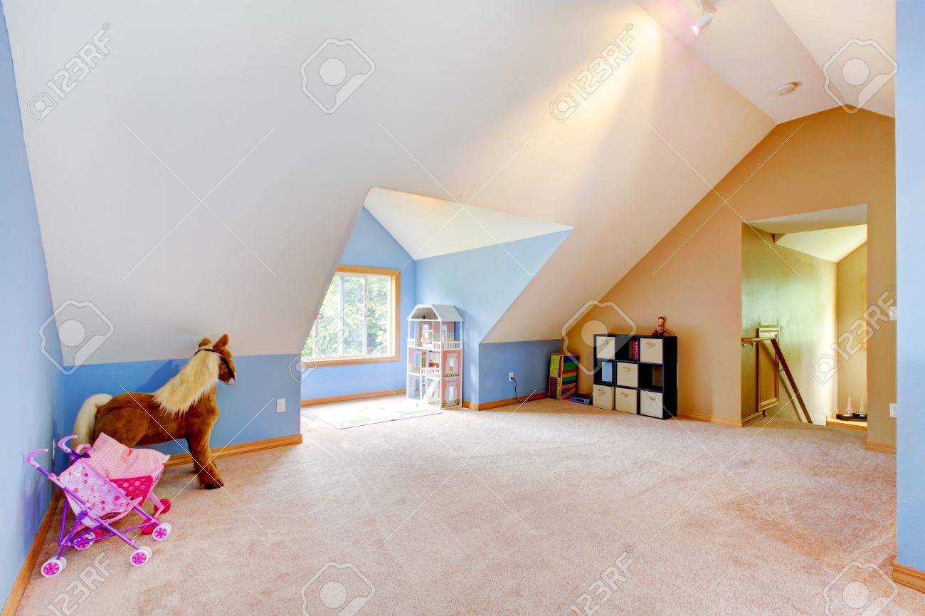 Attic Living Room blue attic living room with toys and play area with vaul ceiling