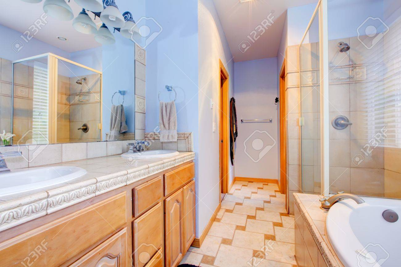 Blue large bathroom with tub and shower and wood cabinets Stock Photo - 16335345