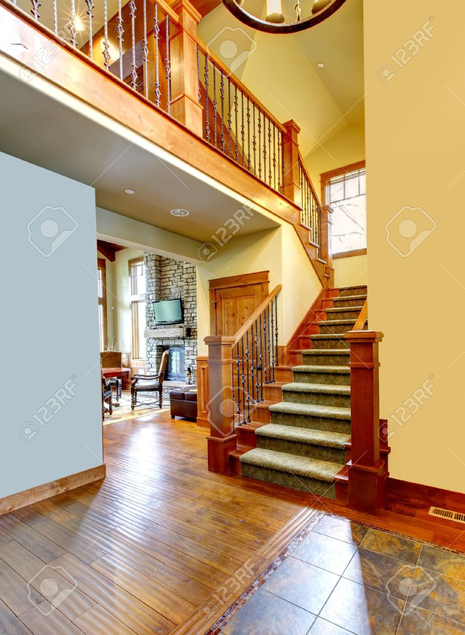 Mountain luxury home staircase with wood railings. Stock Photo - 16662817