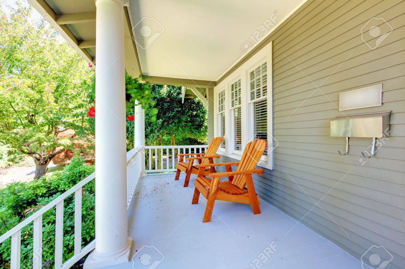Covered front porch craftsman style home royalty free stock image - Front Porch With Chairs And Columns Of Old Craftsman Style Home Stock Photo 16727844