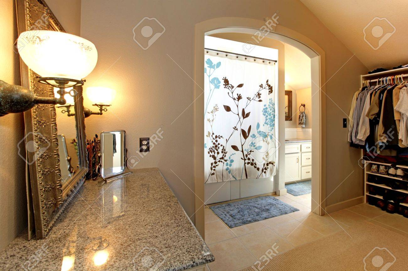 Large closet  room with door to bathroom with shower. Stock Photo - 16752347