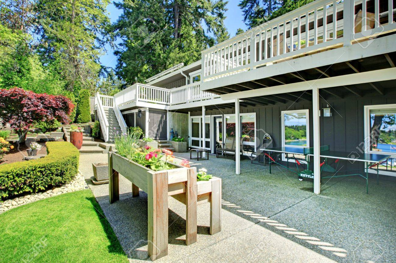 Large house back yard with two decks and flower boxes. Stock Photo - 17056341