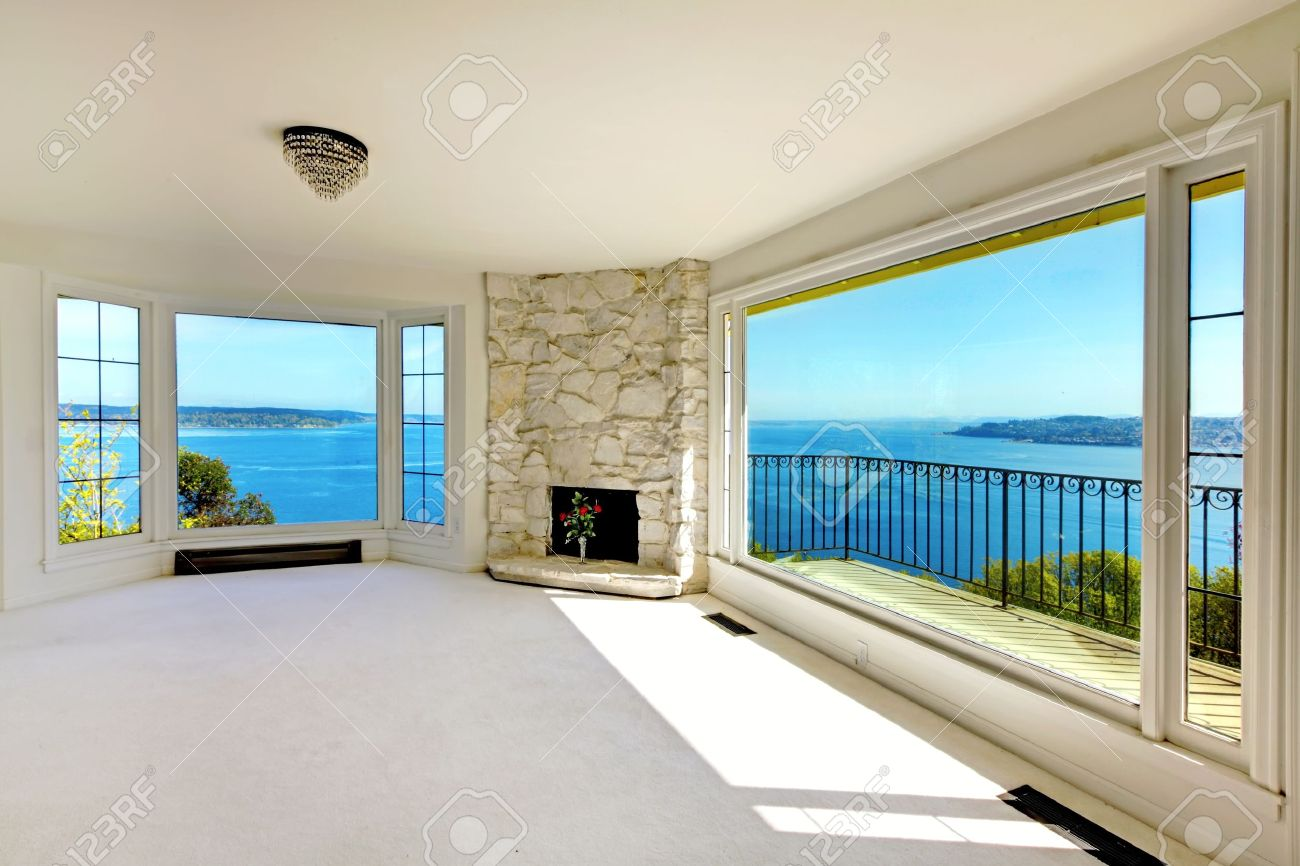 Luxury real estate empty bedroom with water view and fireplace. Stock Photo - 17100590