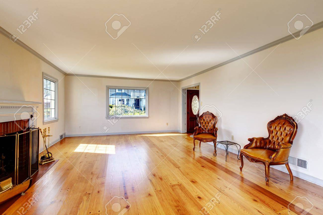 Empty chair in room - Large Empty Old Living Room Interior With Fireplace And Two Chairs Stock Photo 17100587