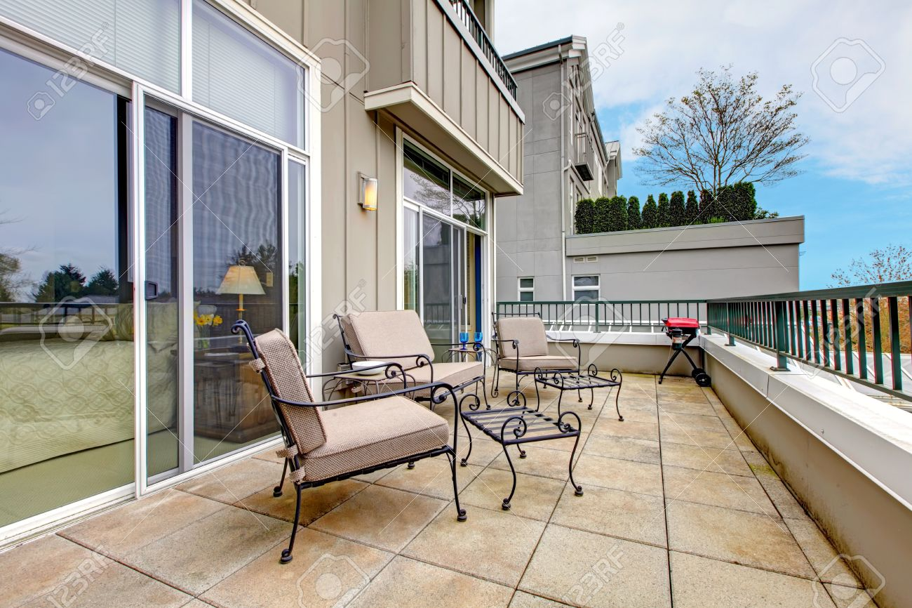Balcony, large terrace with furniture in new apartment building.