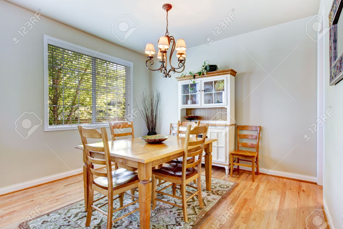 Natural Grey Dining Room Interior With Wood Table And Cabinet Stock Photo