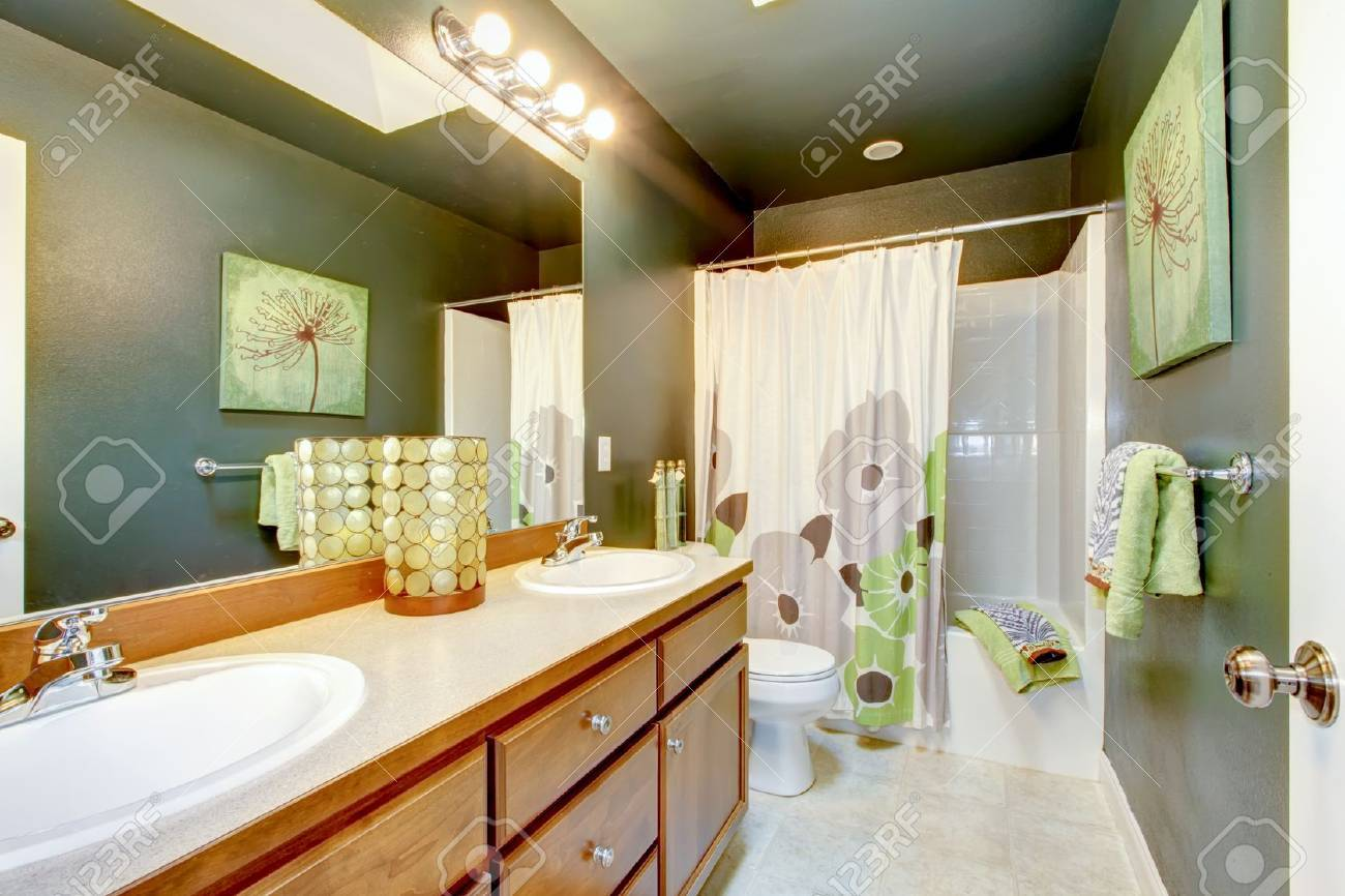Green bathroom with wood cabinet and shower tub. Stock Photo - 17749800