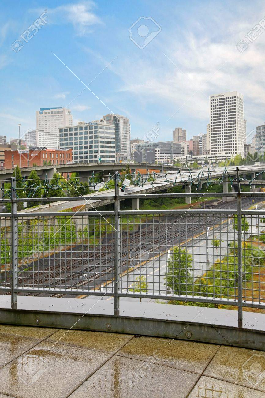 Balcony with metal railing and city view in rain  Tacoma Stock Photo - 17771888