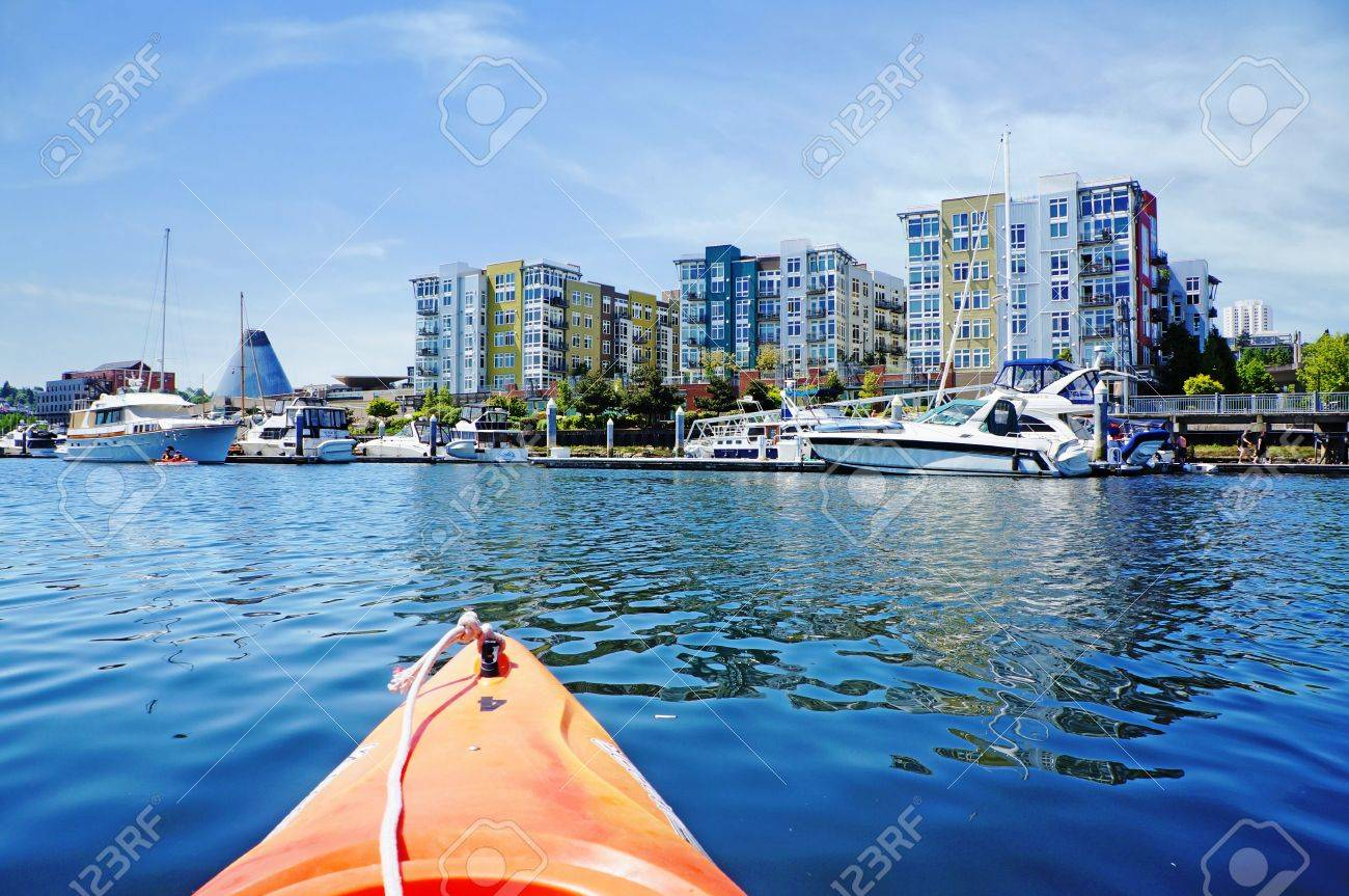Modern apartment building exterior with glass museum and marina  Tacoma Stock Photo - 17771889