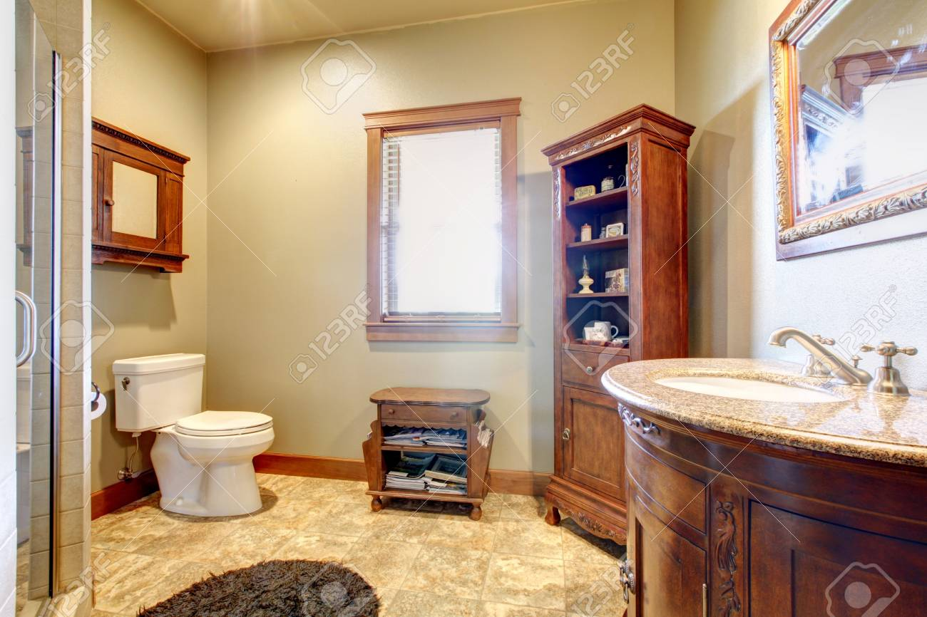 Large bathroom with wood furniture and natural colors. Stock Photo - 17848871
