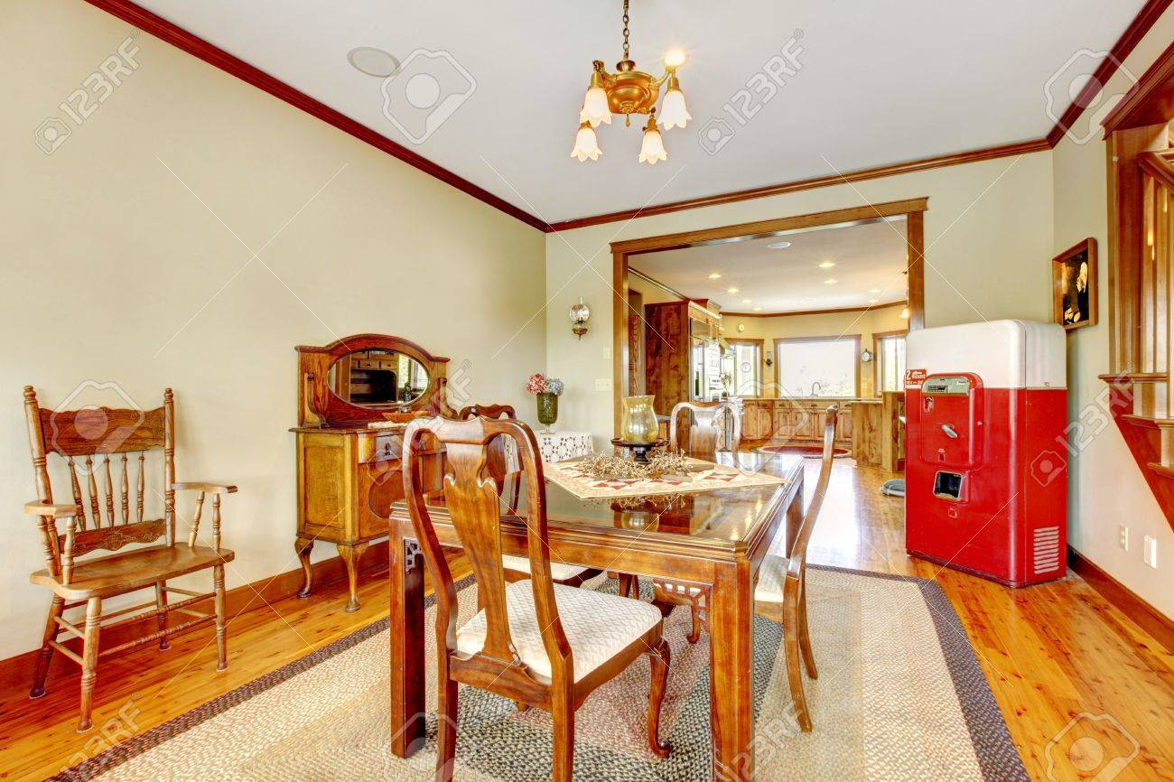 Green dining room with antque cooler and wood furniture. Stock Photo - 17848875