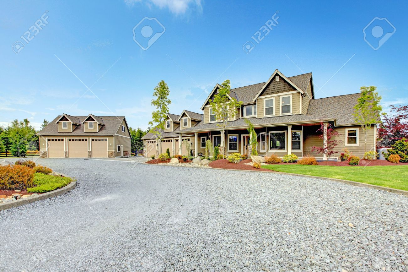 Large farm country house with gravel driveway and green landscape. - 17848840