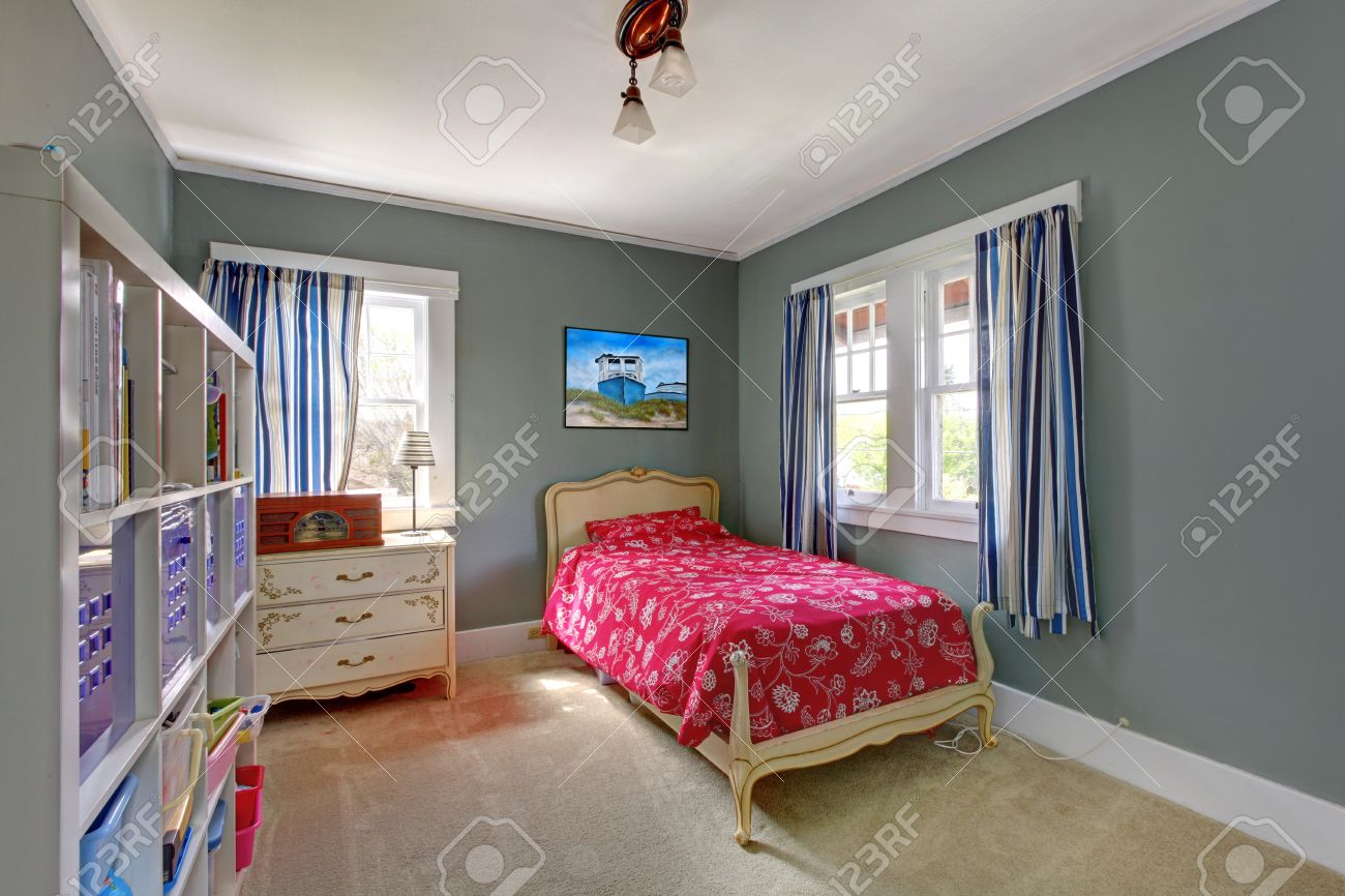 Kids teenager  with red bed and grey walls. Stock Photo - 18174428