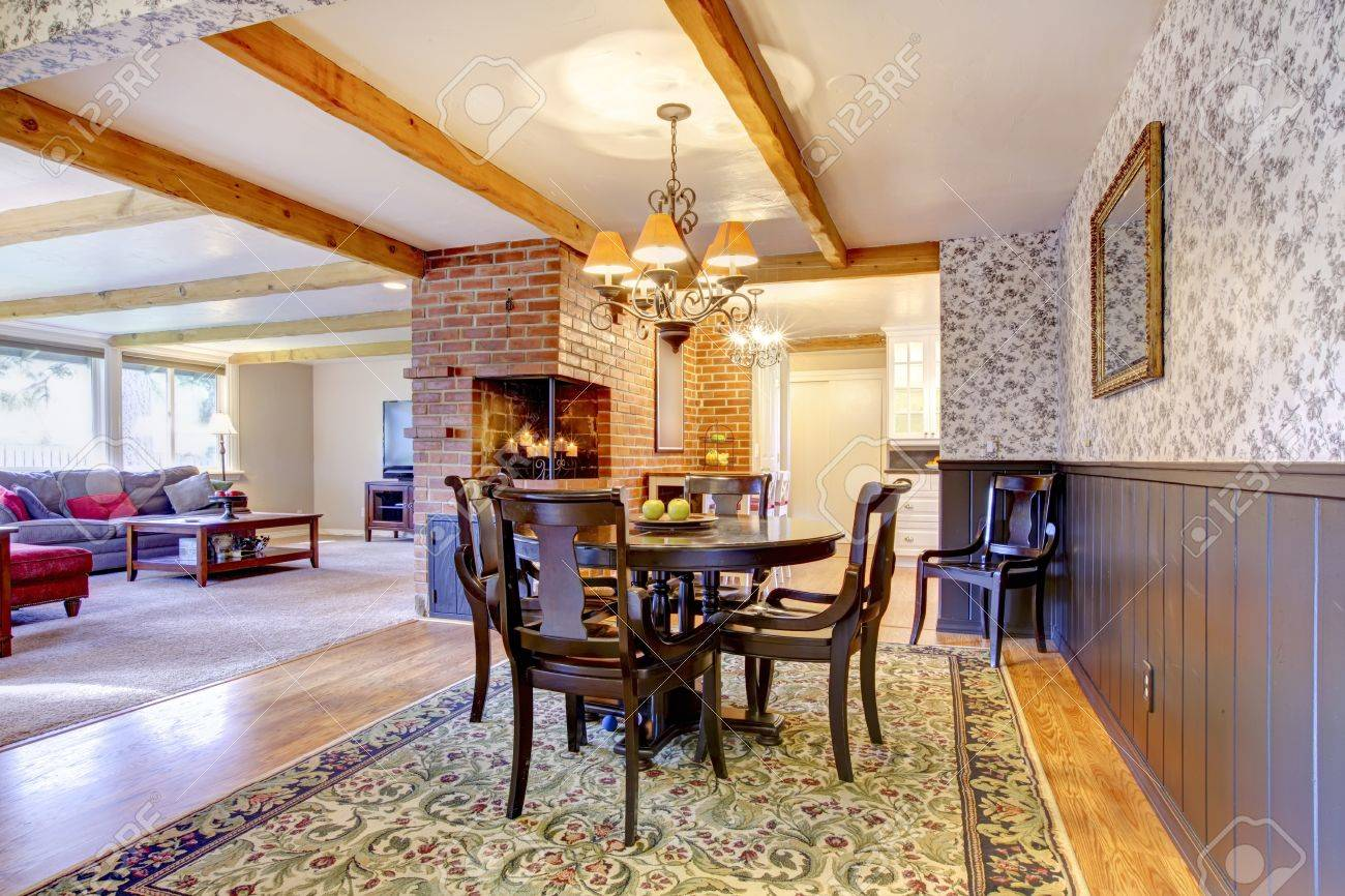 Dining Room Near Brick Fireplace And Living Open Floor Plan Stock Photo