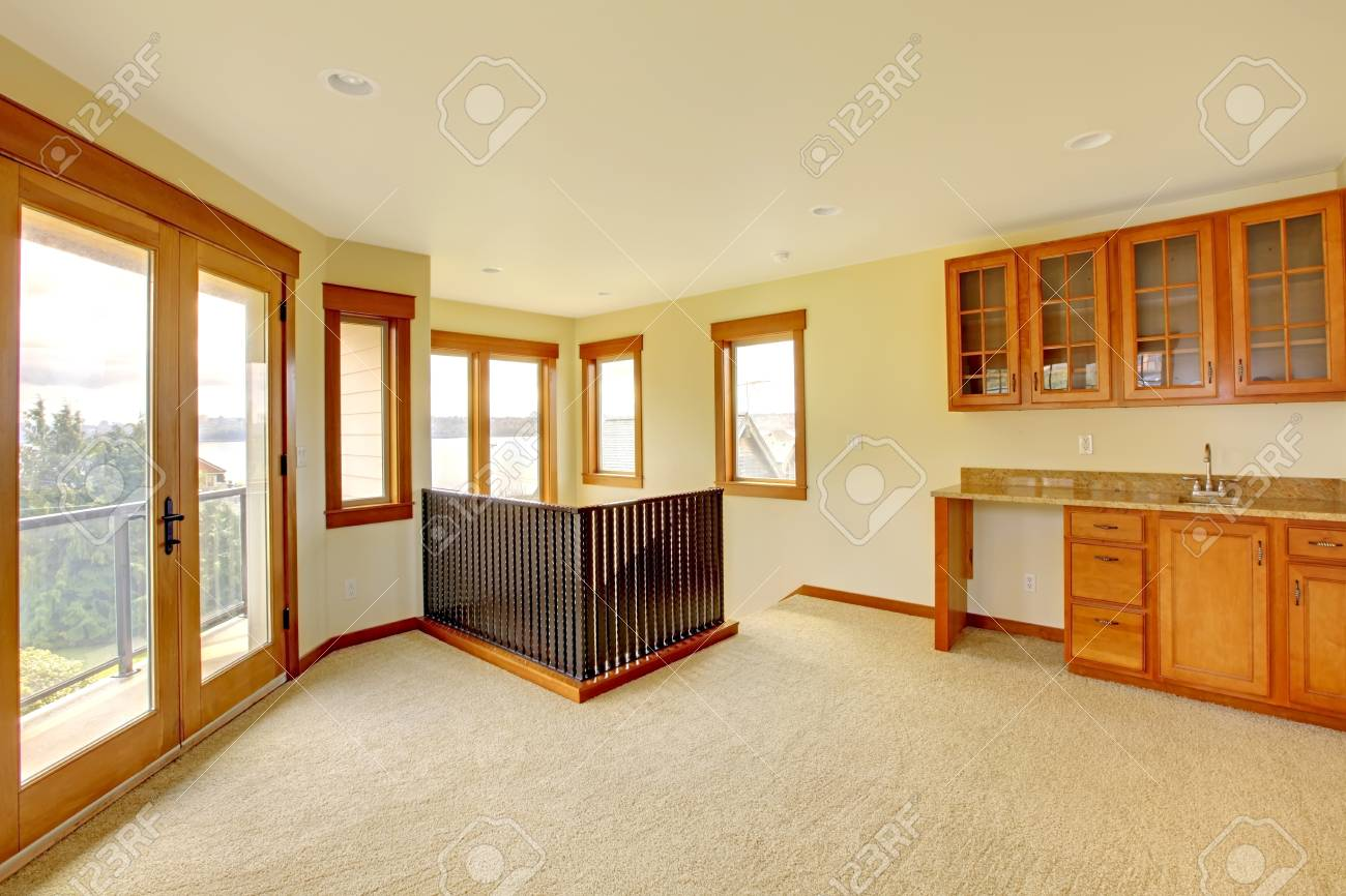 empty large room with wood cabinets new luxury home interior stock