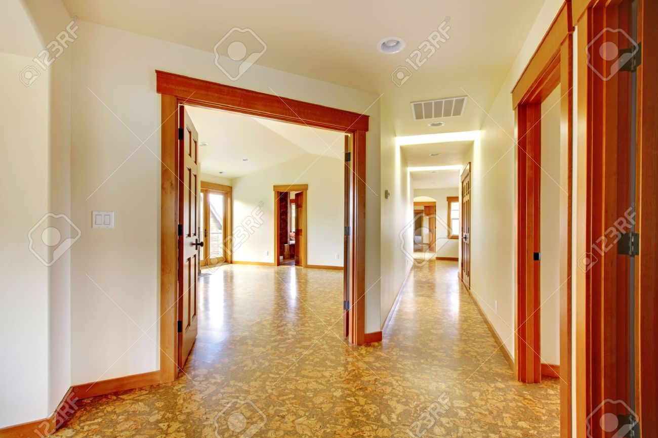 Large hallway in empty house with cork floor. New luxury home interior. Stock Photo - 18283827