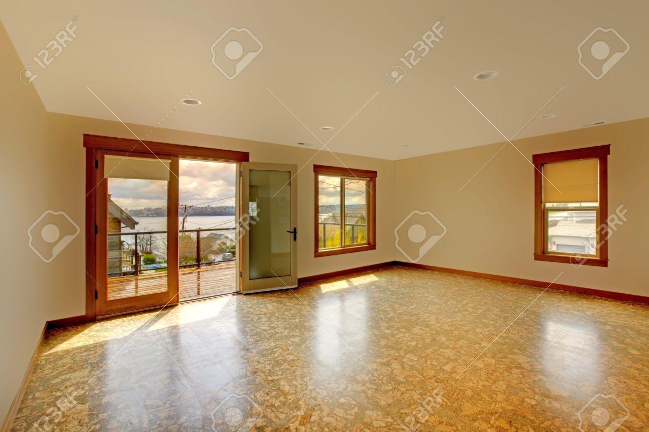 lage bright empty room with cork floor and balconynew luxury home interior stock - Cork Home Interior