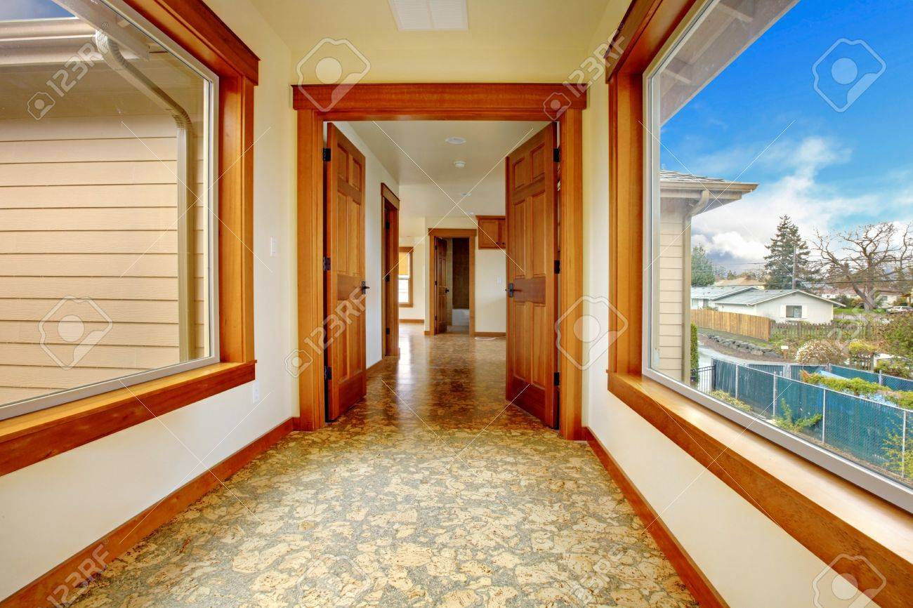 large hallway in empty house with cork floor new luxury home interior stock photo - Cork Home Interior